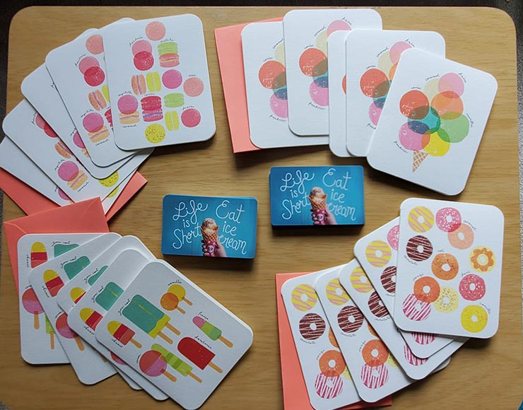 Thank-you cards and gift cards for ice cream on a table