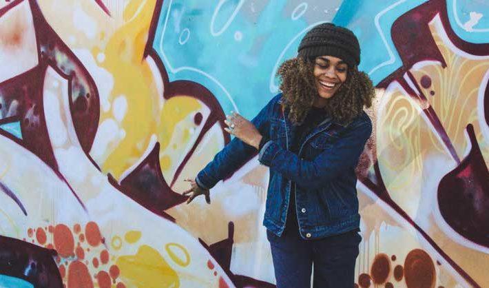 Girl having fun dancing on the street