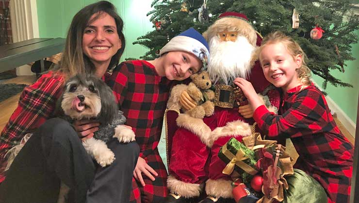 Au pair Carolina and her host kids celebrate traditions on Christmas morning.