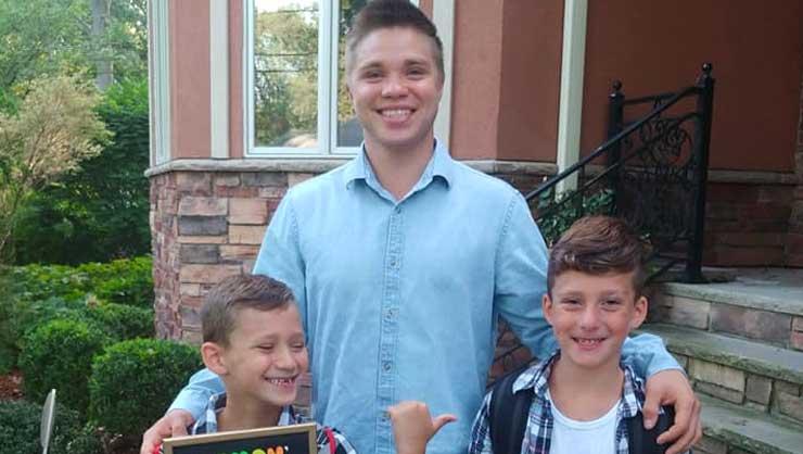 Russian au pair Efim with his host kids, Simon and Elia.